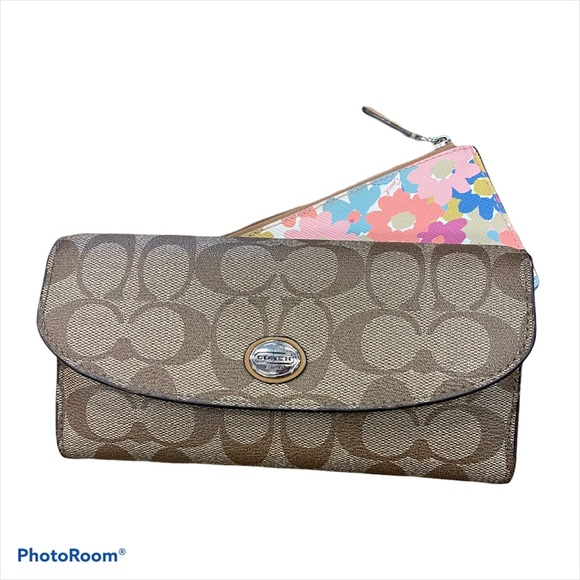 Coach signature wallet with floral zip insert
